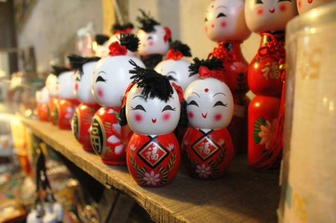 a chinese doll collection in a store