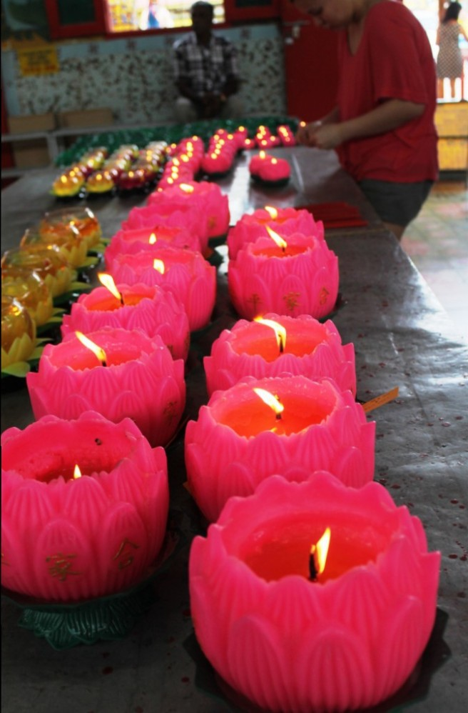 prayer lamps at the thai buddhist temple