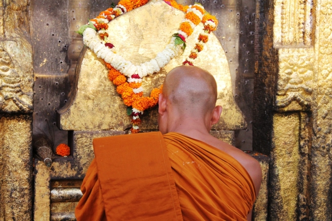 8. Devotion - a monk prays in Bodh Gaya